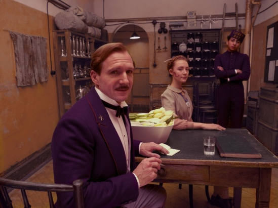 Ralph Fiennes, Saoirse Ronan and Tony Revolori in 'The Grand Budapest Hotel.'  credit: premiere.fr